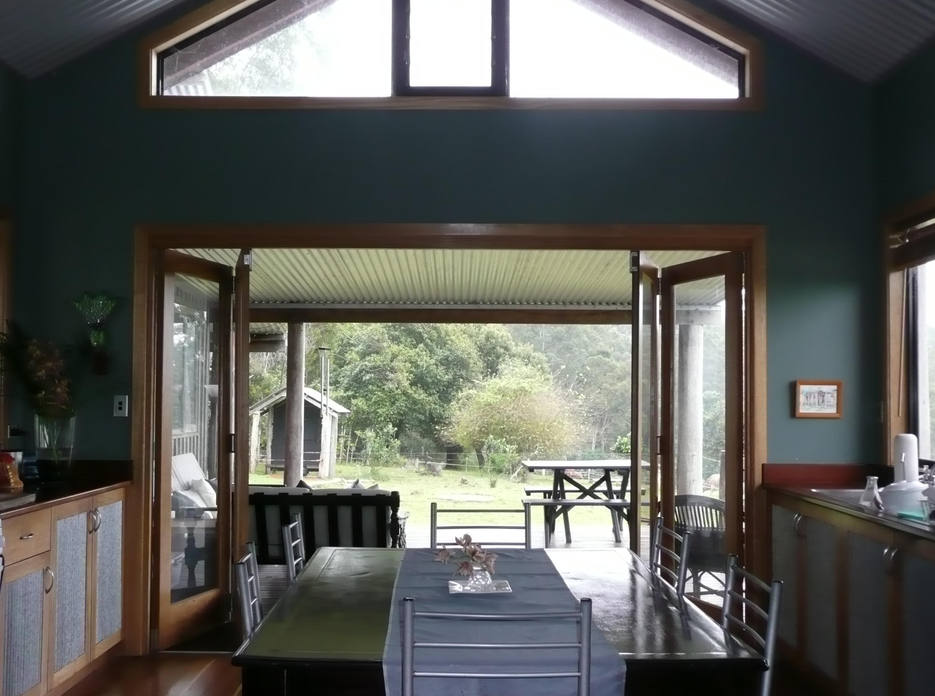 Bi Fold Doors In Kitchen Lead Out Onto Large Veranda